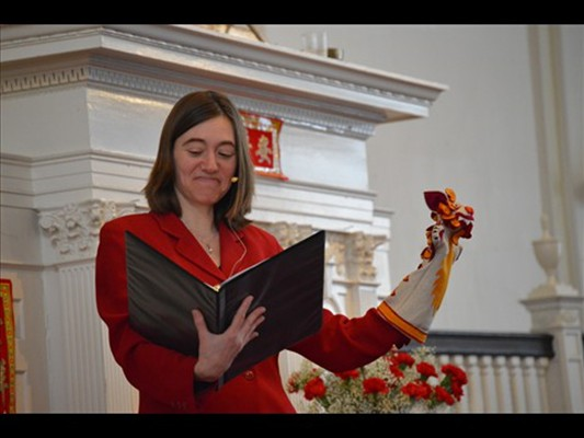 Director of Religious Education Mandy Neff reads a story for all ages during worship